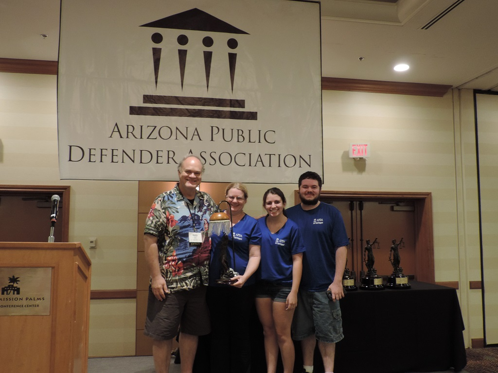 LItigation Support Analyst Susie Tapia and family received a special award for 15 years of supporting the Conference